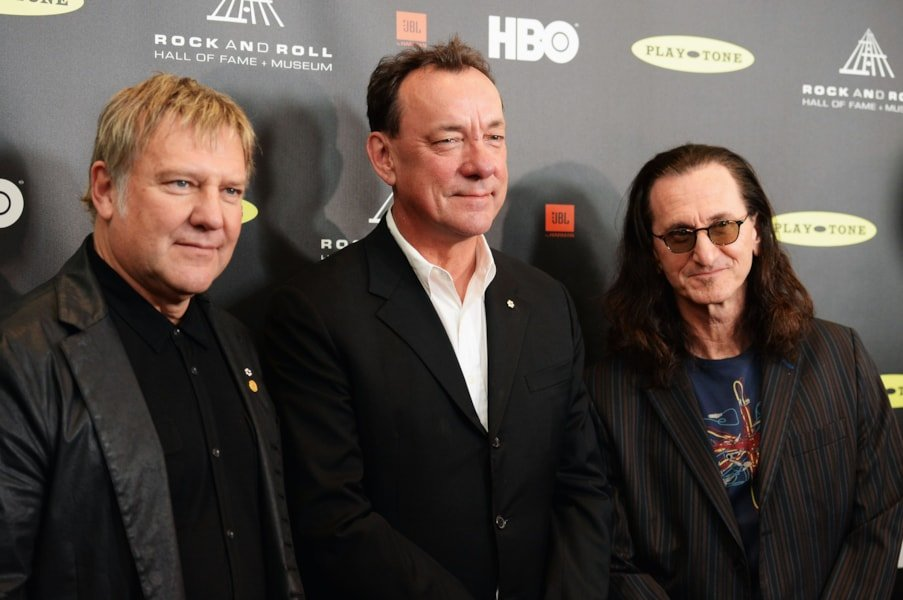 LOS ANGELES, CA - APRIL 18: (L-R) Inductees Alex Lifeson, Neil Peart and Geddy Lee of Rush arrive at the 28th Annual Rock and Roll Hall of Fame Induction Ceremony at Nokia Theatre L.A. Live on April 18, 2013 in Los Angeles, California.  (Photo by Jason Merritt/Getty Images)