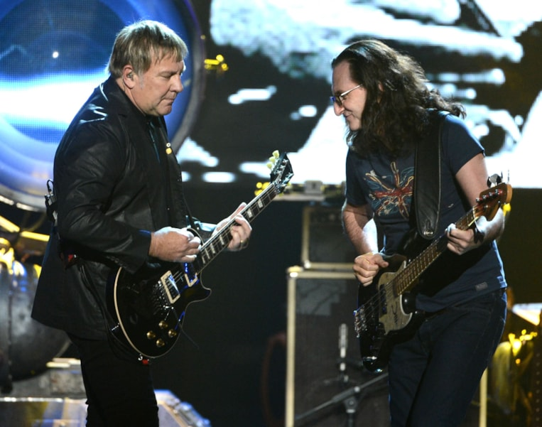LOS ANGELES, CA - APRIL 18:  Inductees Alex Lifeson and Geddy Lee of Rush perform on stage at the 28th Annual Rock and Roll Hall of Fame Induction Ceremony at Nokia Theatre L.A. Live on April 18, 2013 in Los Angeles, California.  (Photo by Kevin Winter/Getty Images)