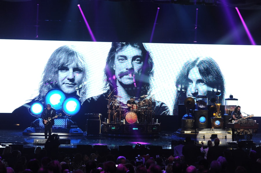 LOS ANGELES, CA - APRIL 18:  (L-R) Inductees Alex Lifeson, Neil Peart and Geddy Lee of Rush perform onstage at the 28th Annual Rock and Roll Hall of Fame Induction Ceremony at Nokia Theatre L.A. Live on April 18, 2013 in Los Angeles, California.  (Photo by Kevin Winter/Getty Images)