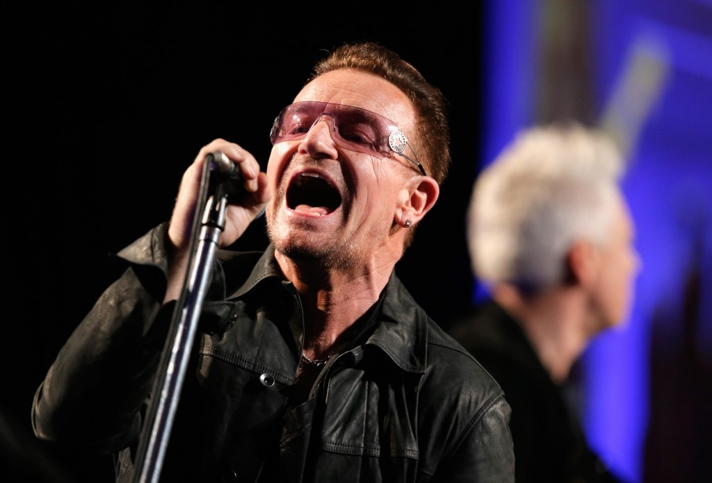 BEVERLY HILLS, CA - JANUARY 11:  Bono of U2 performs onstage during the 3rd annual Sean Penn & Friends HELP HAITI HOME Gala benefiting J/P HRO presented by Giorgio Armani at Montage Beverly Hills on January 11, 2014 in Beverly Hills, California.  (Photo by Joe Scarnici/Getty Images for J/P Haitian Relief Organization)
